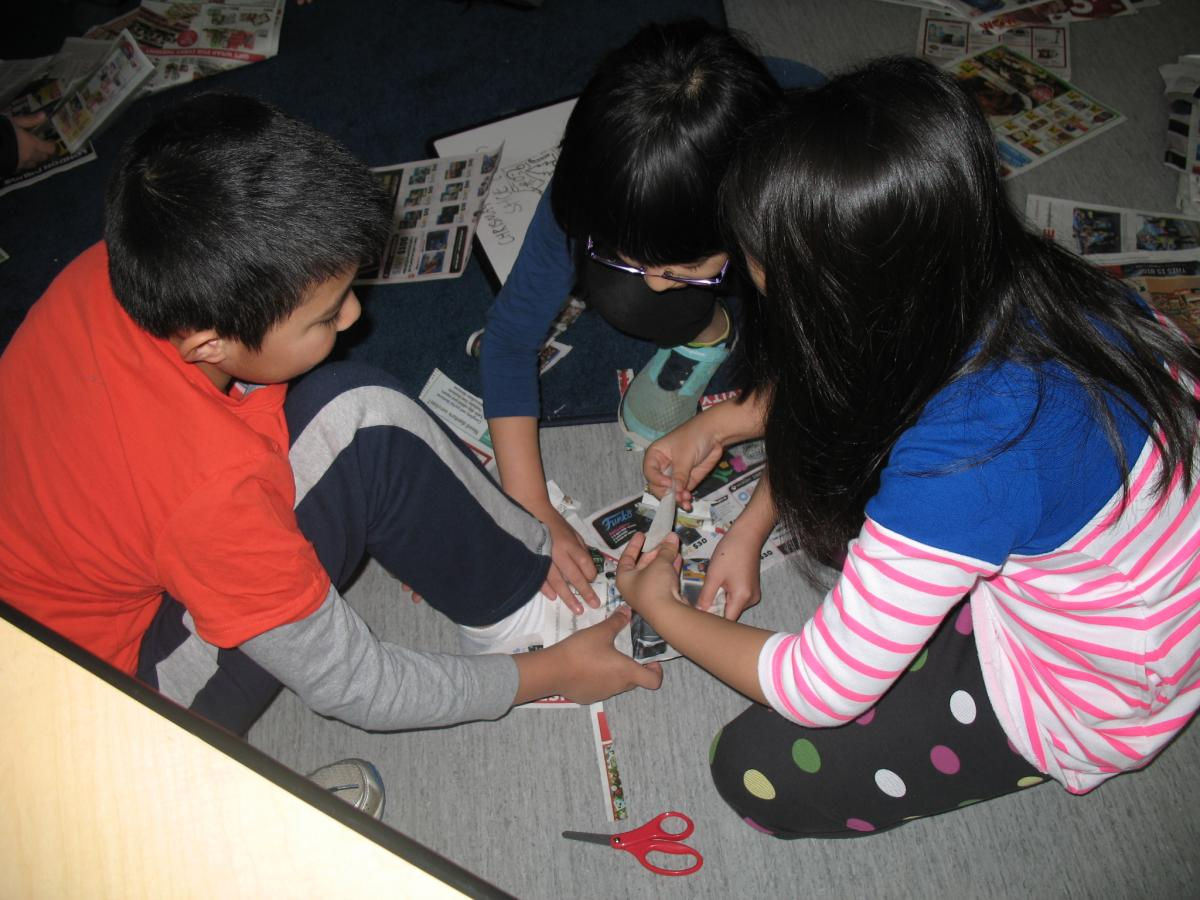 Working collaboratively to make a newspaper shoe